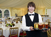 Young waiter serving drinks